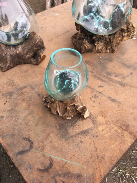 Glass blown molded to driftwood.